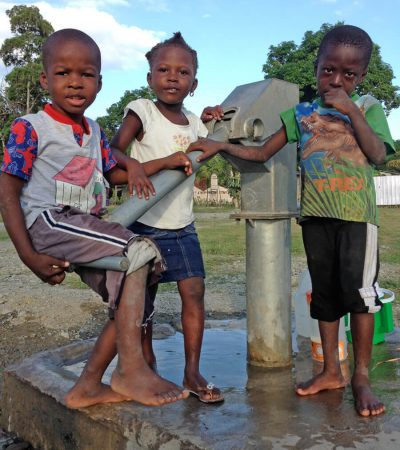 Kids at water pump
